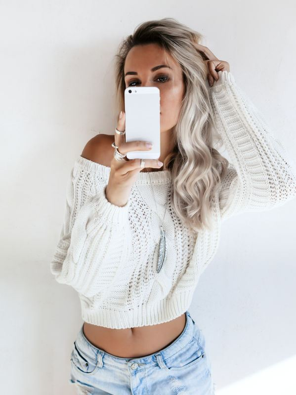 Confident woman taking selfie