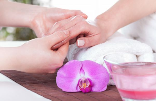 A woman having a chemical peel treatment on her hand.