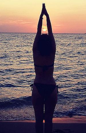 Slender healthy woman at beach feeling good again.